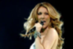 Celine Dion singing into a microphone