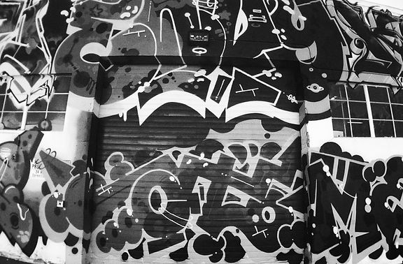 Black and white photo of graffiti