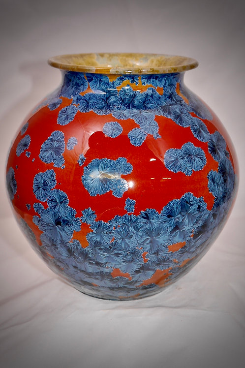 Rounded vase with red ground and steel blue crystals