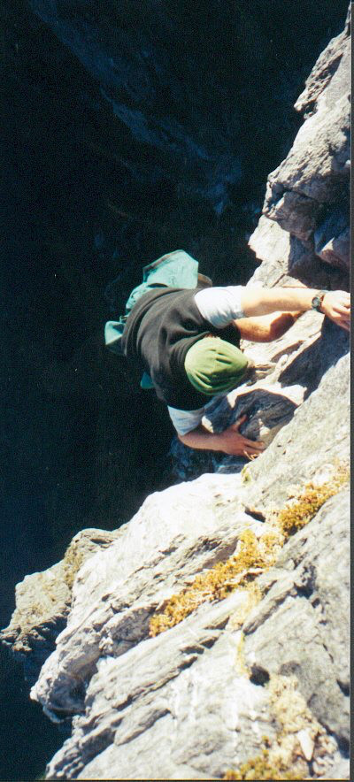 the 'exposed section' of the climb up Federation Peak. Patrice finds his way up this short but highly exposed piece.