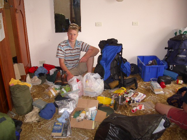 Woolza figuring out how to get 30kg of gear into his pack - Jan 5th 2004