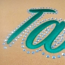 Custom embroidery with jeweled outline for our customers varsity jacket.jpg