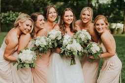 Beautful bride and her Ladies.  Classic white Flowers.