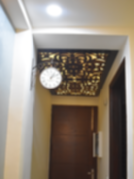 Hanging Clock in home Foyer