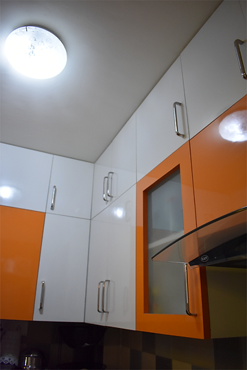 Modular Kitchen Upper Cabinet design in Orange & White combination