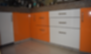 Modular Kitchen Lower Cabinet design in Orange & White Combination