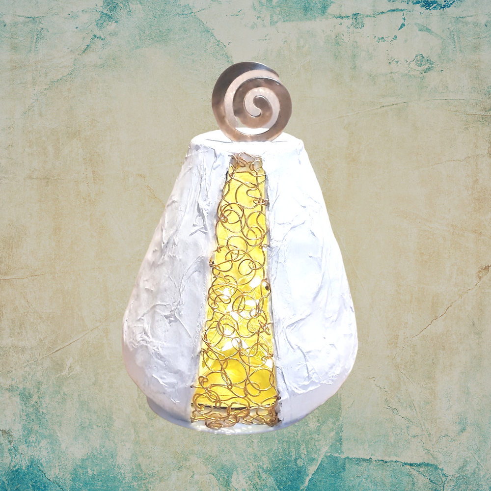 A papiermache form with a metal wound and a spiral feature made by Katie Gayle
