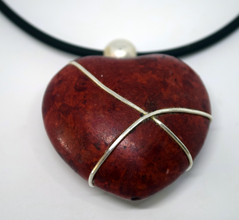 A red heart repaired with silver