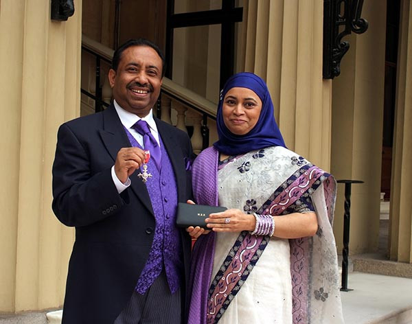 Bajloor with his wife after receiving his MBE at Buckingham Palace