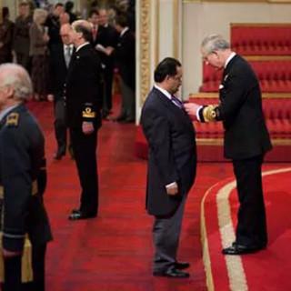 Bajloor receiving his MBE in 2012 from Prince Charles