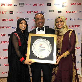 Receiving a Curry Life Award with his daughters