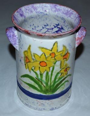 Churn vase with daffodils