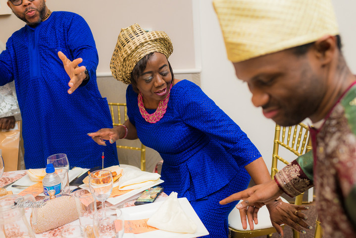 Guests having a great time at a Nigerian event