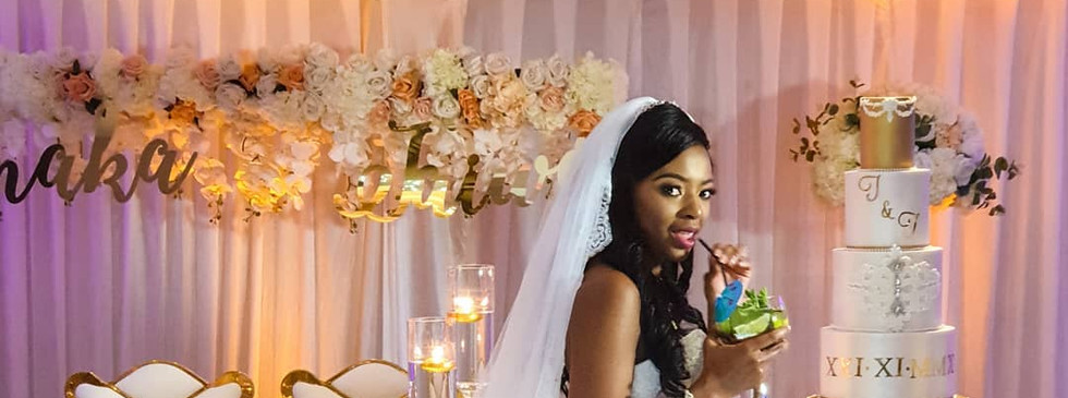 Bride having a sip of her cocktail