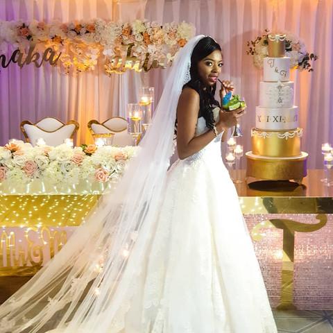 Bride having a sip of her cocktail. Nigerian Wedding