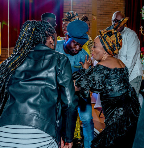 Guests dancing to afrobeats music at a Nigerian wedding