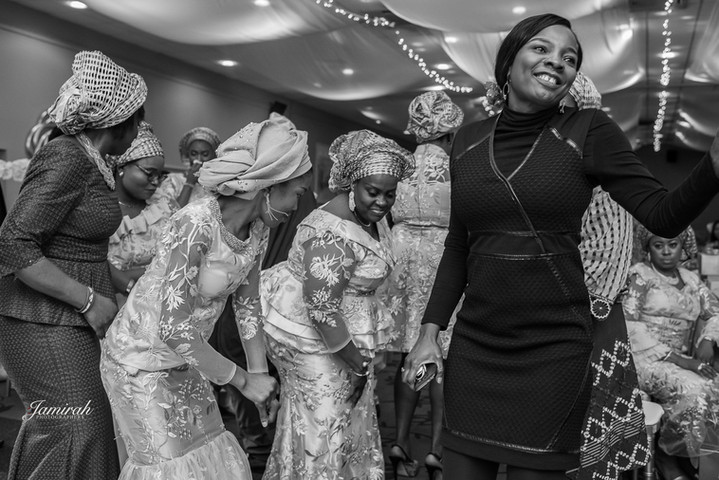 Friends and family of the bride on the dance floor at a Nigerian wedding event