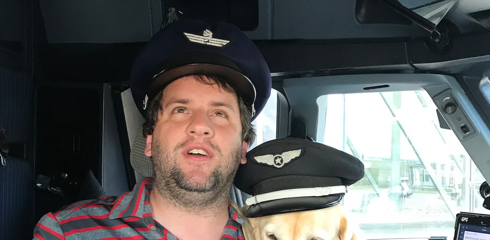 Juan Pablo Culasso in the airplane cabin with his guide dog 2017