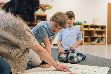 Young boy learning at Montessori school.