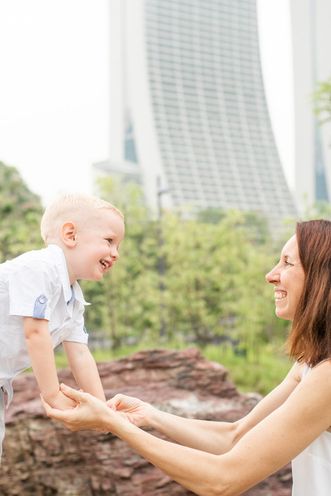 Singapore Lifestyle Photographer   Nic Imai Photography   Outdoor breastfeeding photo session Gardens By The Bay Singapore laughing mummy and son