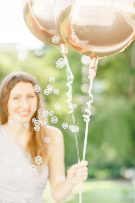 Fort Canning Singapore birthday photo shoot with balloons and bubbles