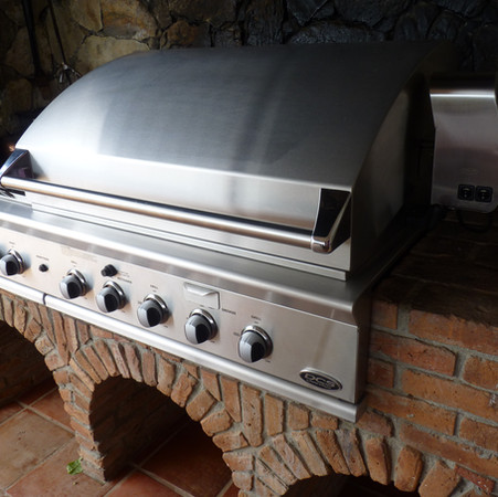 Built in grill with rotisserie on dining veranda