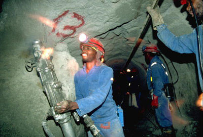 Miners wearing blue conti suits, safety equipment