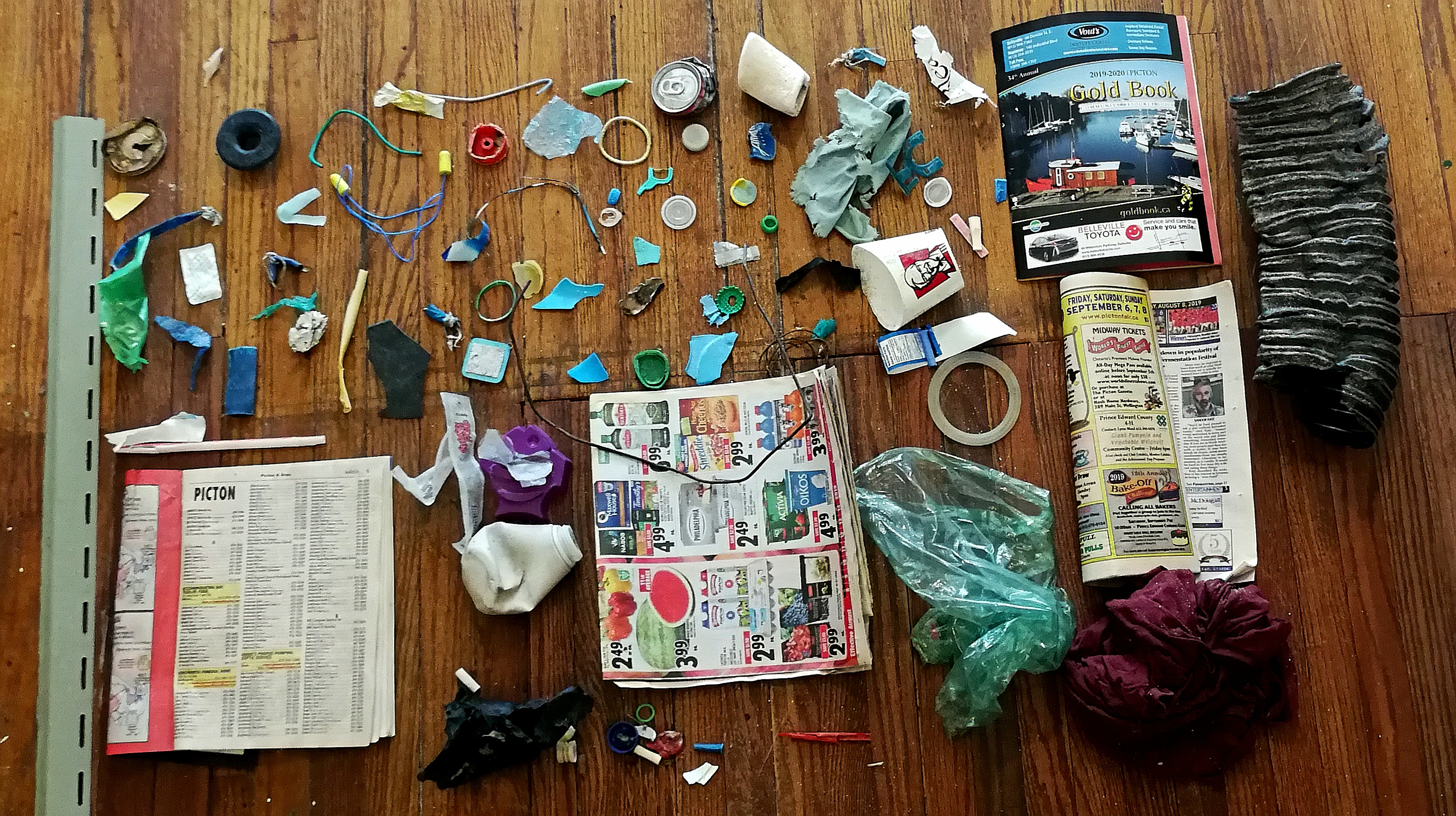 Debris found on local streets and beaches, used in set design.