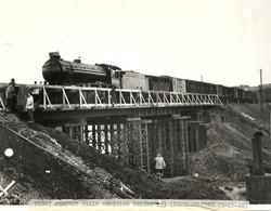 Irish goods train crossing bridge 233