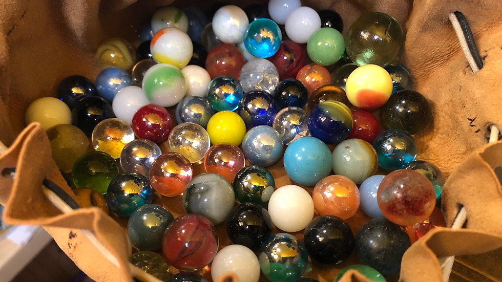 81 unique antique/vintage marbles in leather pouch