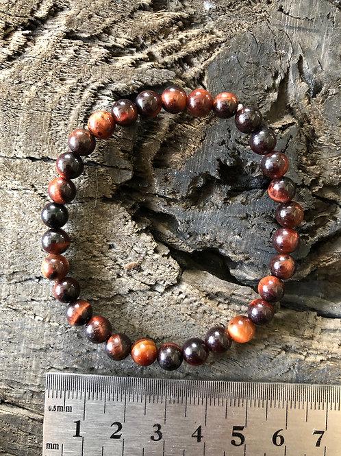 Okseøje armbånd 6 mm. perler ca. 12 gr.