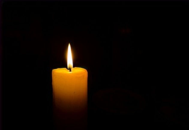 108498823-close-up-candle-flame-black-background-_edited_edited.jpg