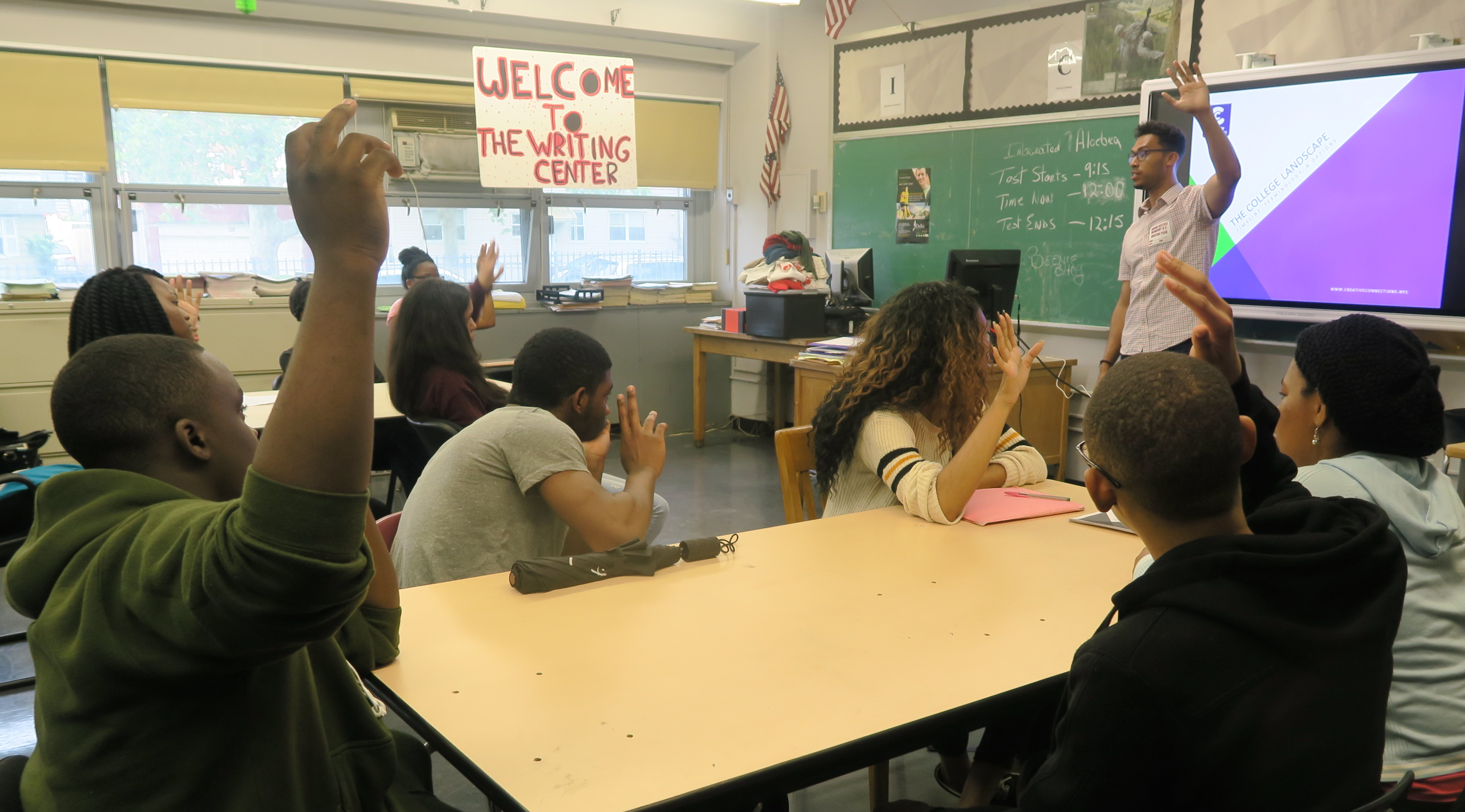 students raising hands.JPG