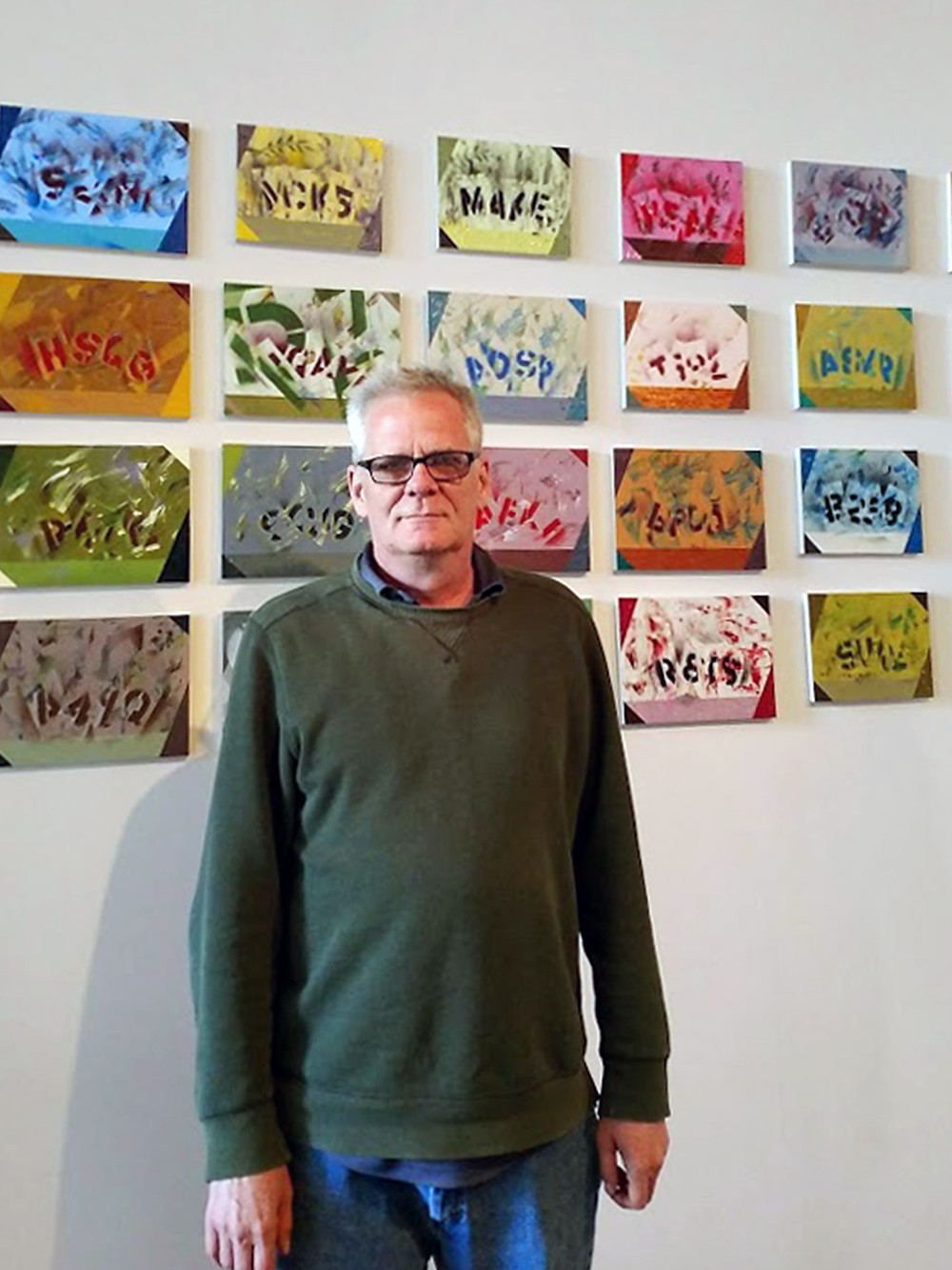 Trip Denton in front of his art work at Side Street Gallery, Philadelphia.