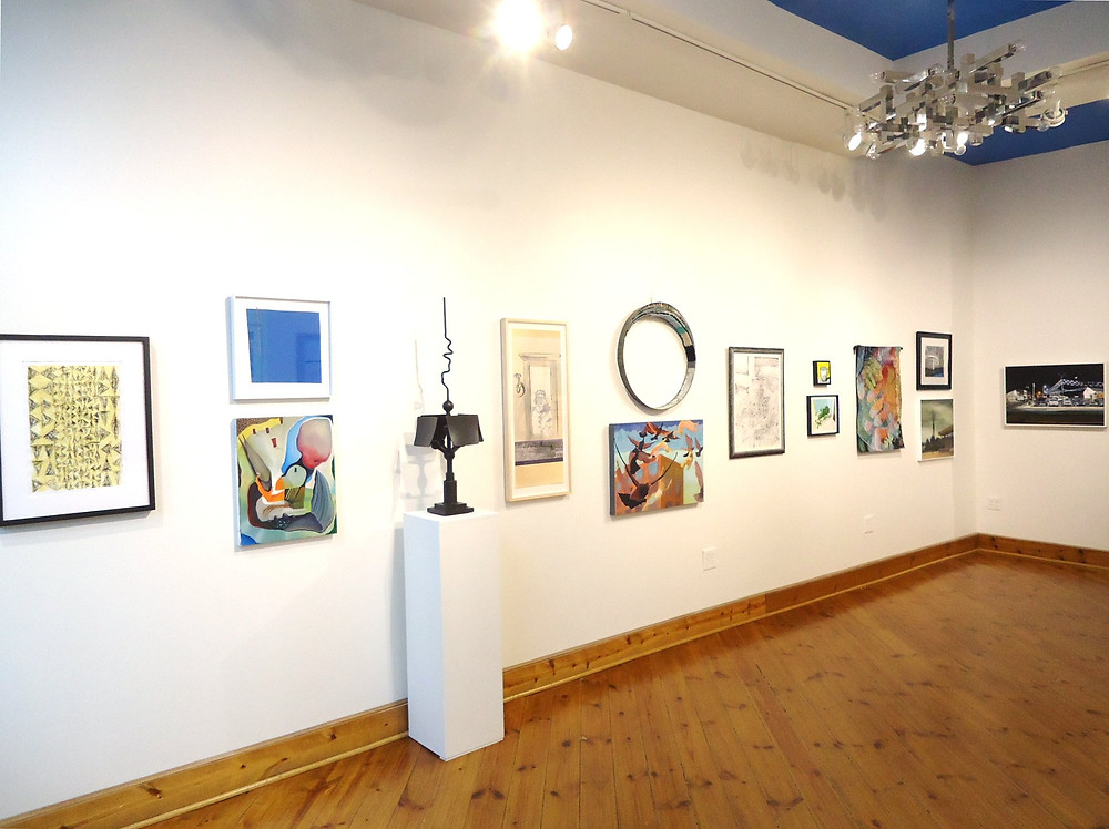 Left-side wall 7th Annual Juried Exhibition from the entry