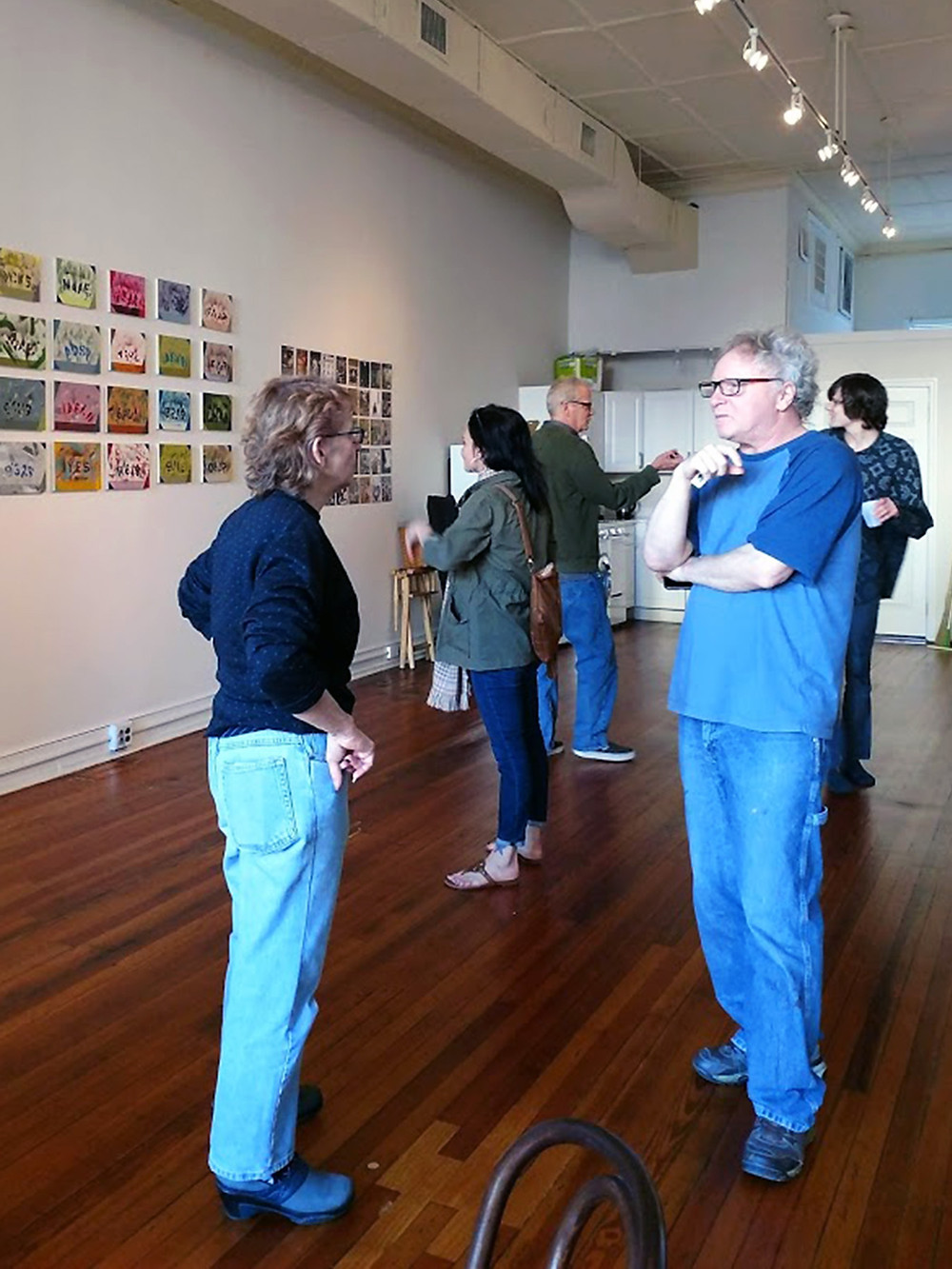 Ruth Wolf (left) talking to Harvey Weinreich (right) at Side Street Gallery, Philadelphia.