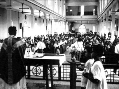 Mass being celebrated in the mid 60 by Fr Aloysius Doraisamy