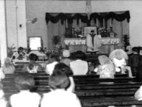Mass in pre-Vatican II days in Latin. Note the celebrant has his back to the congregation