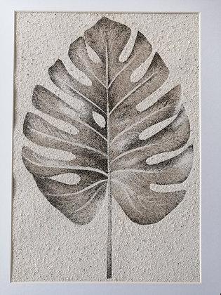 Tableau de sable d'une feuille de Monstera
