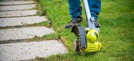 grass-trimmer-edging-a-path-424439.jpg
