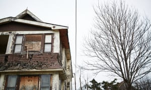 A boarded-up home at the end of the street that Jamal Collins grew up on in East Cleveland.