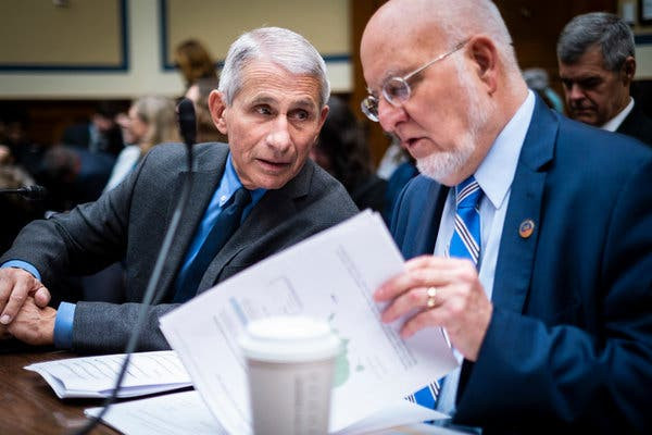 Dr. Anthony Fauci and Dr. Robert Redfield, two leading members of the administration's public health team, were ready to back a shift in administration strategy by late February.