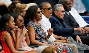 March 2016: the Obamas react along with Cuban president Raúl Castro at an exhibition baseball game in Havana.