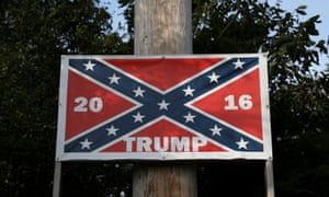 'There's not many white Americans left. They're a dying breed …' a confederate flag on a  Trump poster in North Carolina.