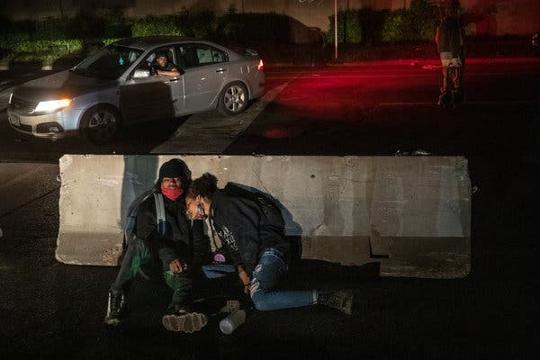 Protesters took a moment of rest after a confrontation during demonstrations overnight.