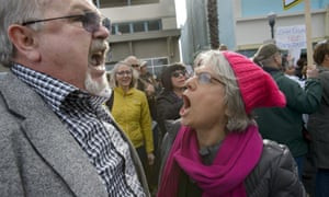 Trump supporter Lance Snead, left, is confronted by an anti-Trump protester, Louise Isaacson, during a rally in Roseville on Saturday.