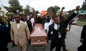 A demonstration led by activist Quanell X (right) in 2013, in Houston, over the death of Trayvon Martin.