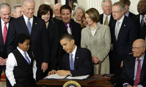 Barack Obama signs the 'Obamacare' healthcare bill in the East Room of the White House in Washington on 23 March 2010.