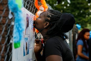The aunt of Jahnae Patterson kisses a picture of her niece during a vigil.