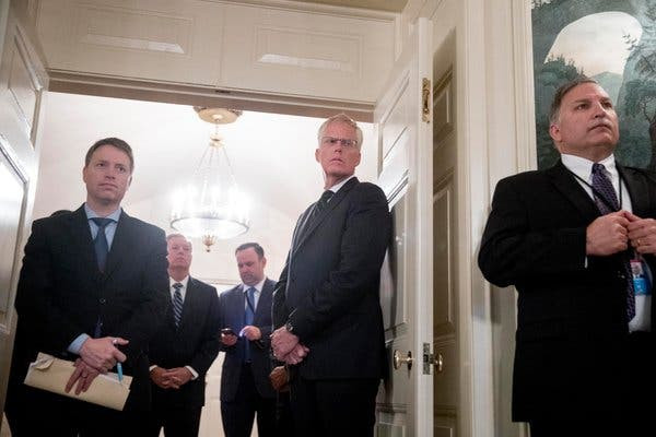 Matthew Pottinger, left, the deputy national security adviser, was among those in the administration who pushed for imposing limits on travel from China.